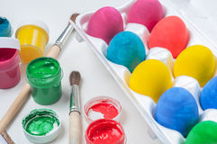 Set of colorful Easter eggs. Jars of paints and brushes Stock Photo