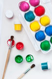 Set of colorful Easter eggs. Jars of paints and brushes Stock Photography