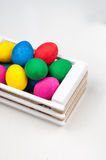 Set of colorful Easter eggs. In a white wooden box Royalty Free Stock Photography