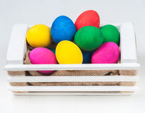 Set of colorful Easter eggs. In a white wooden box Royalty Free Stock Images