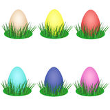 Set of colorful eggs in green grass. For Easter holiday Stock Photos