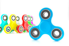 Set of colorful fidget spinners. Fidget spinners with different colors. Very popular toy for distress relief. 3d render illustration Stock Photo