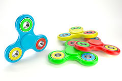 Set of colorful fidget spinners. Fidget spinners with different colors. Very popular toy for distress relief. 3d render illustration Royalty Free Stock Images
