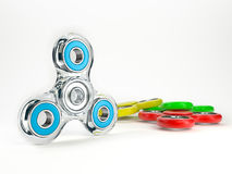 Set of colorful fidget spinners. Fidget spinners with different colors. Very popular toy for distress relief. 3d render illustration Royalty Free Stock Image