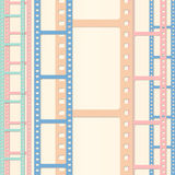 Set of colorful film or camera strips in vertical position. Set of colorful film or camera strips on beige background Royalty Free Stock Photo