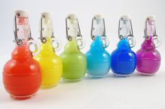 Set of Colorful flasks. Colorful closed flask disposition, from red to purple Royalty Free Stock Photos