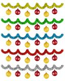 Set of garlands of tinsel with balls. Set of colorful garlands of tinsel with balls isolated on white Royalty Free Stock Image