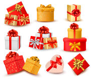 Set of colorful gift boxes with bows and ribbons. Royalty Free Stock Image