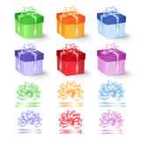 Set of colorful gift boxes with bows and ribbons. Royalty Free Stock Photo