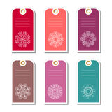 Set of colorful gift tags with abstract snowflakes. Royalty Free Stock Photography