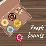 Set of colorful glazed donuts in a box. Vector illustration Royalty Free Stock Images