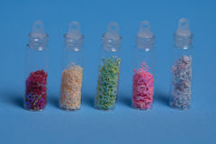 Set of colorful glitters Stock Images