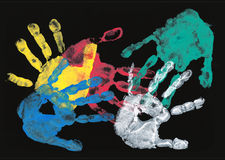 Set of colorful hand prints on black. Background Stock Photo