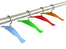 Set of colorful hangers on a metal pipe Stock Photography