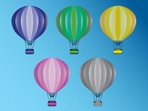A set of colorful hot air balloons flying in the sky vector illustration