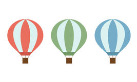 Set of colorful hot air balloons of red green and blue colors with a basket and ropes isolated on white background Stock Photography