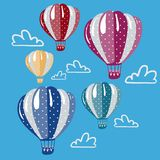 Set of colorful hot air balloons in the sky stock images