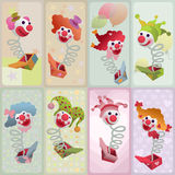 Set of 8 colorful jack in the box puppets. Set of cards - colorful jack in the box puppets popping out of boxes Stock Images