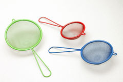 Set of colorful kitchen strainers, close-up Stock Photography