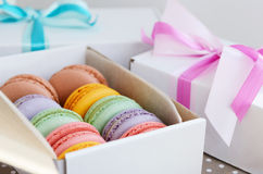 Set of colorful macaroon and gift boxes with ribbon and bow Stock Photography