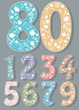 Set of Colorful Numbers with White Floral Decor stock images
