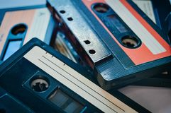 Set of colorful old audio cassettes background stock image