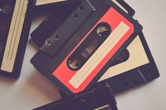 Set of colorful old audio cassettes background. 80s-90s royalty free stock image