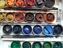 Set of colorful paint with brush Stock Photos