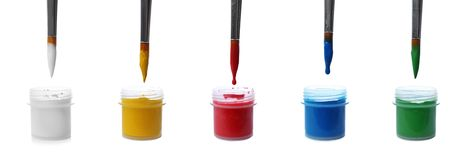 Set of colorful paint brushes and plastic jars. On white background royalty free stock image
