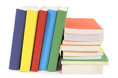 Collection of library books, stacked, leaning, isolated white background Royalty Free Stock Images