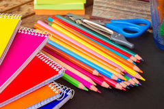 Set of colorful pencils on black board Royalty Free Stock Image