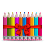 Set colorful pencils decorated by bow on white bac Royalty Free Stock Photography