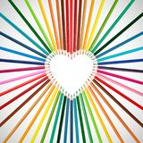 Set of colorful pencils in middle of heart shape Royalty Free Stock Photo