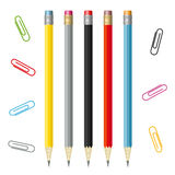 Set of colorful pencils and paperclips Royalty Free Stock Photo