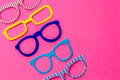 Set of colorful photo booth eyeglasses on pink background with c royalty free stock photos