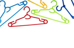 Set of colorful plastic clothes hangers stock image