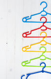 Set of colorful plastic clothes hangers Stock Images