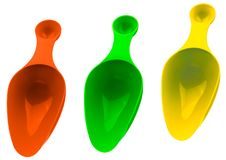 Set of colorful plastic measuring spoon isolated on white background with shadow. Orange, green, and yellow plastic measuring stock image