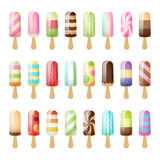Set of colorful popsicles on wooden sticks. Royalty Free Stock Image