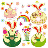 Set of colorful rabbit and springtime floral Royalty Free Stock Photos