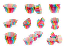 Set of colorful rainbow paper tins for baking cake muffin cupcak Stock Images
