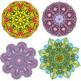 Set of 4 colorful round ornaments Stock Images