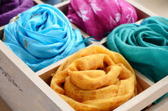 Set of colorful scarfs in wooden box stock photo