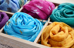 Set of colorful scarfs in wooden box Royalty Free Stock Photos