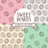 Set of colorful seamless backgrounds with cute doodle donuts Royalty Free Stock Photos
