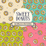 Set of colorful seamless backgrounds with cute doodle donuts Stock Photography
