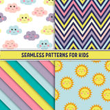 Set of colorful seamless pattern. Childish background with smiling suns and clouds. Holiday design. Vector illustration. Stock Image