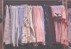 Set of colorful shirt on hanger in fashion shop. royalty free stock image