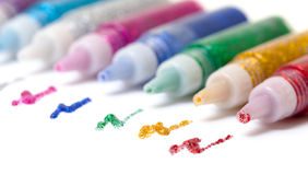 Set Colorful sparkle glue pens stock photos