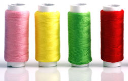 Set of colorful spools of thread. Isolated on white background Stock Photo
